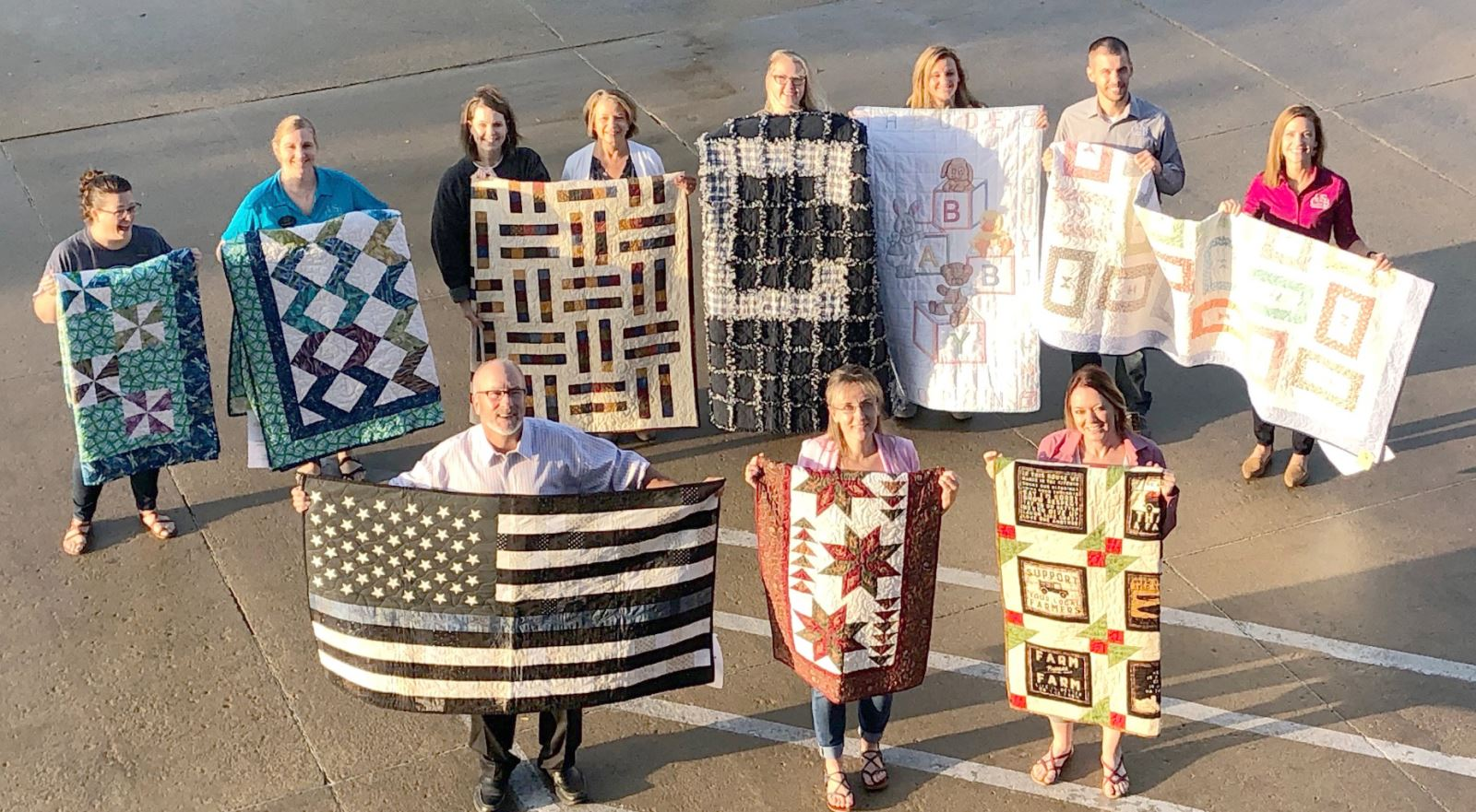 CUSB purchases nine quilts at RHSHC Quilt Auction